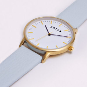 THE GOLD FACE WITH LIGHT BLUE STRAP   VOTCH