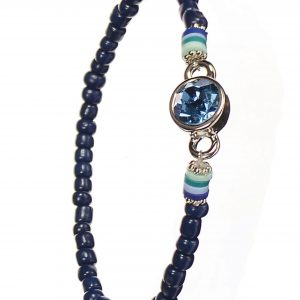This Navy Crystal Row Bead Bracelet features a lovely row of Navy crystals with a sapphire gemstone to contrast.